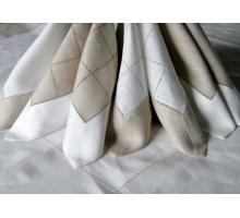 Napkin with sewed edge